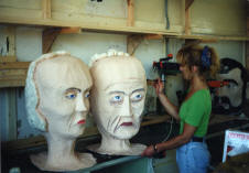 The Giant Heads being painted